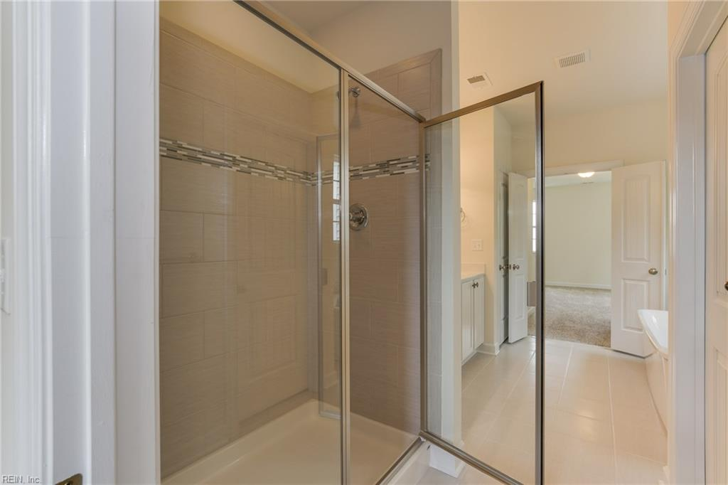 Master bathroom tile walls in shower and floors are standard.  Decorative listello in shower is optional