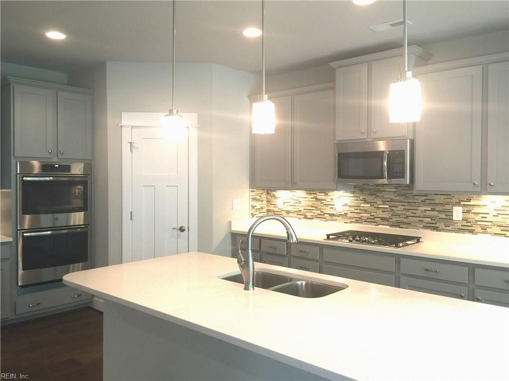 Kitchen perfection!  Large one level island with overhang, undermount sink and quartz counter tops.