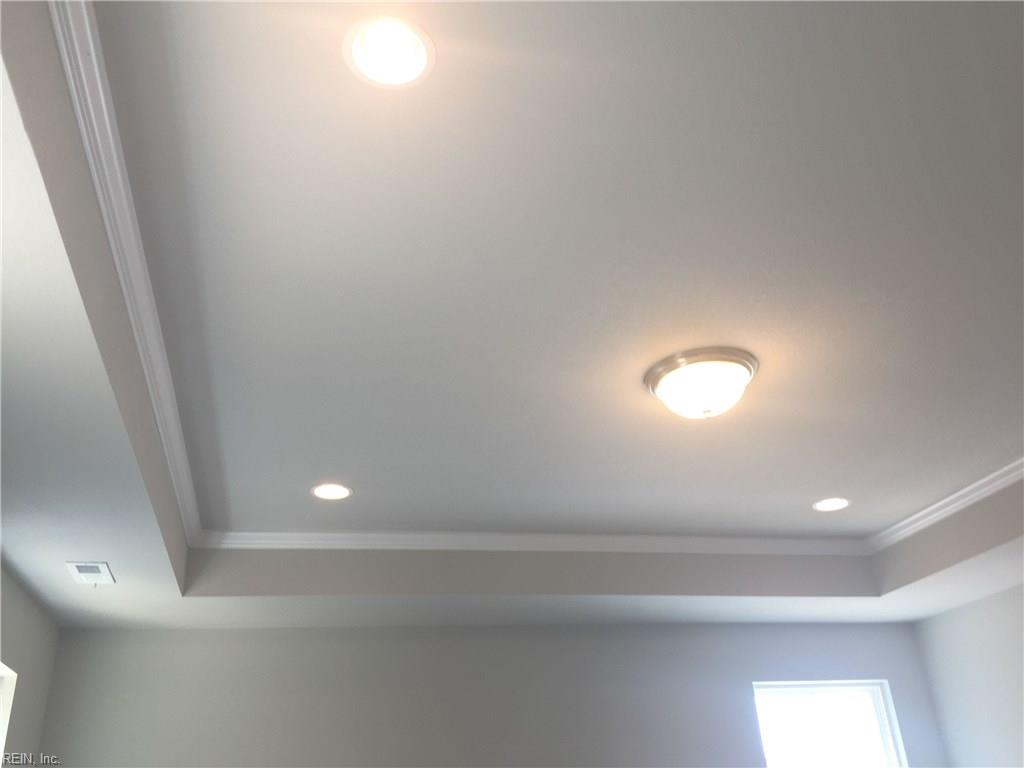 Master bedroom tray ceiling with crown moulding.  Ceiling fan pre-wire and 4 recessed can lights.