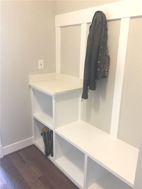Mudroom off garage entry with built in.  Electrical outlet with 2 USB ports in wall just above quartz counter top