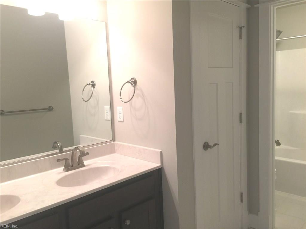 Two room 2nd floor hall bath with double sinks and linen closet.