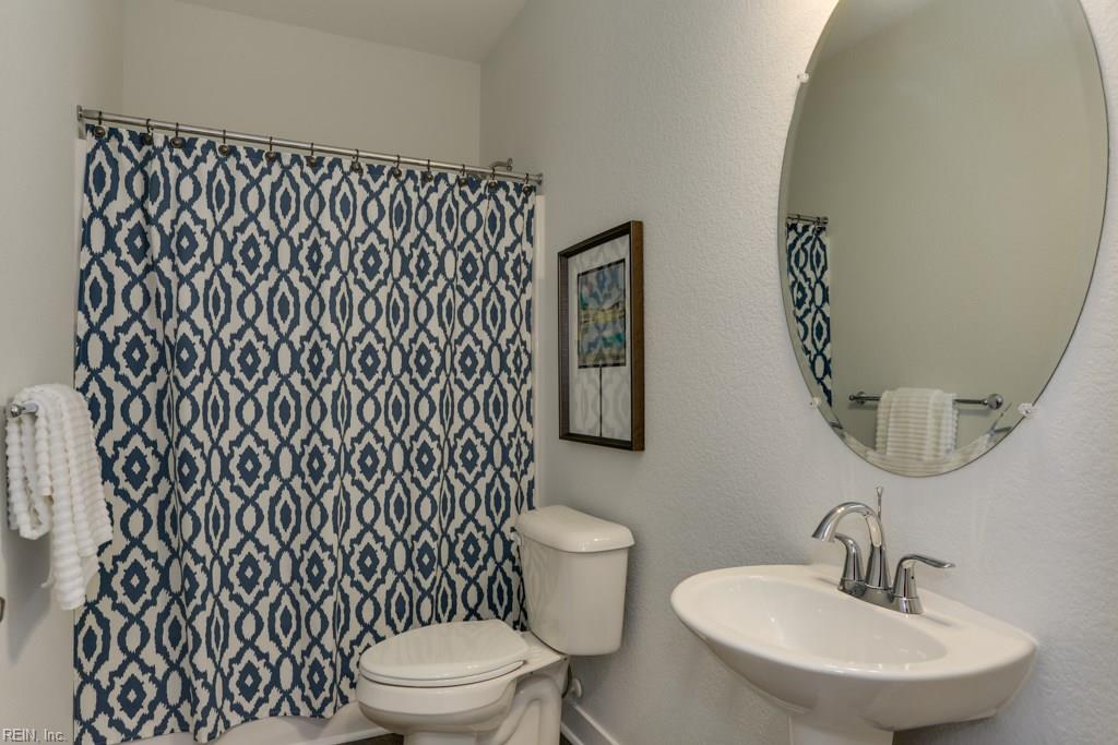 Full bathroom adjoining in law suite.  Photo shown similar to home built