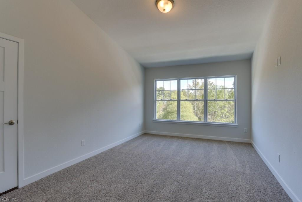 LARGE 3rd floor bedroom.  Photo shown similar to home built