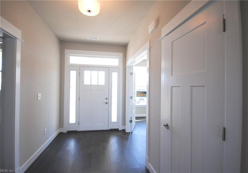 Foyer entry, french doors off foyer lead to flex room/office.