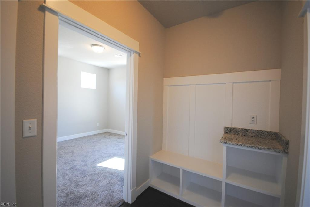 Mudroom built in with outlet/usb ports over counter top.  View of first floor guest room.
