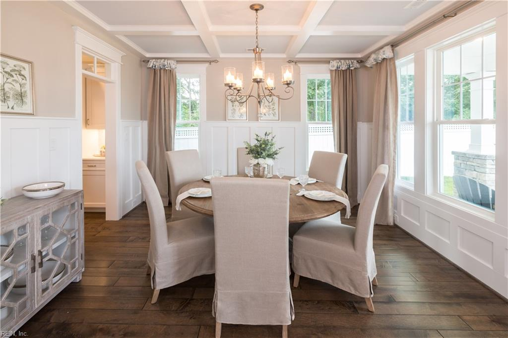 Formal dining area with coastal style wainscot & optional coffered ceiling