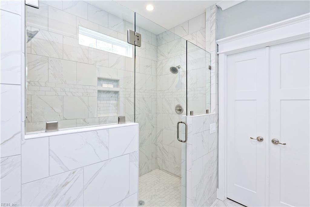 Huge tile shower in 2nd floor master bathroom with dual shower heads