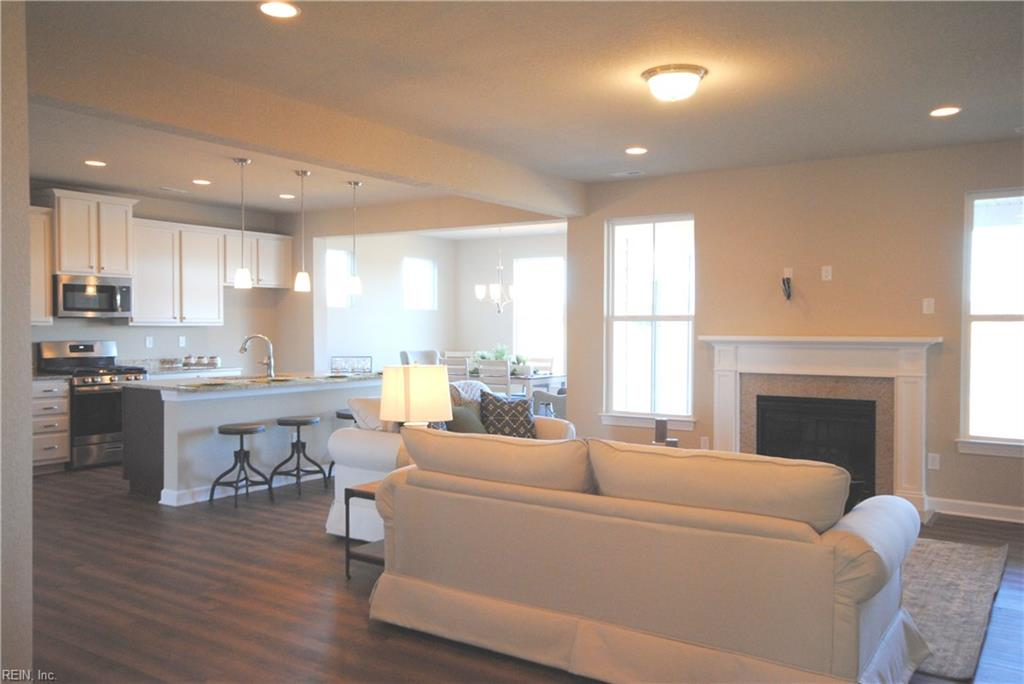 Floor outlet gives power to an end table lamp with no cords showing!  TV wiring over fireplace. -  Similar Photo