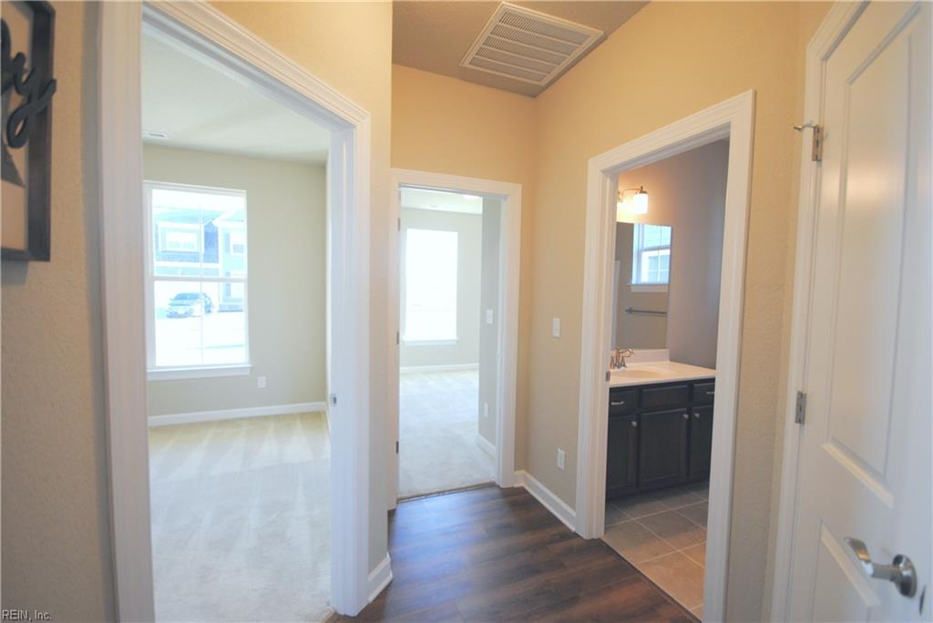 Hallway to bedrooms, full bath and linen closet on right. -  Similar Photo