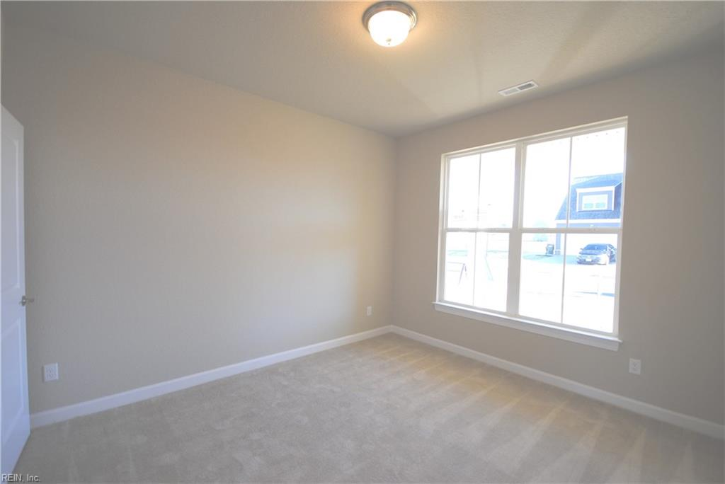 First floor bedroom with walk in closet or you can choose to make this room a study with french doors off the foyer -  Similar Photo