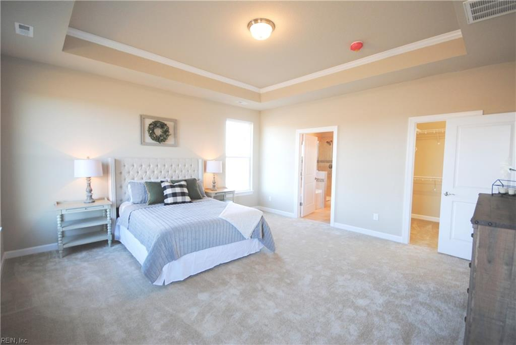 Master bedroom with tray ceiling & crown moulding, 2 walk in closets and master bath.  -  Similar Photo