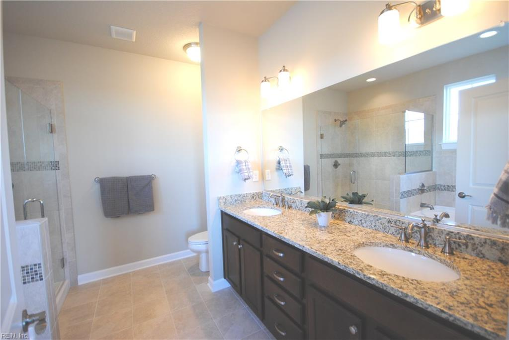 Double vanity sink, optional granite counter tops and tile floor. -  Similar Photo