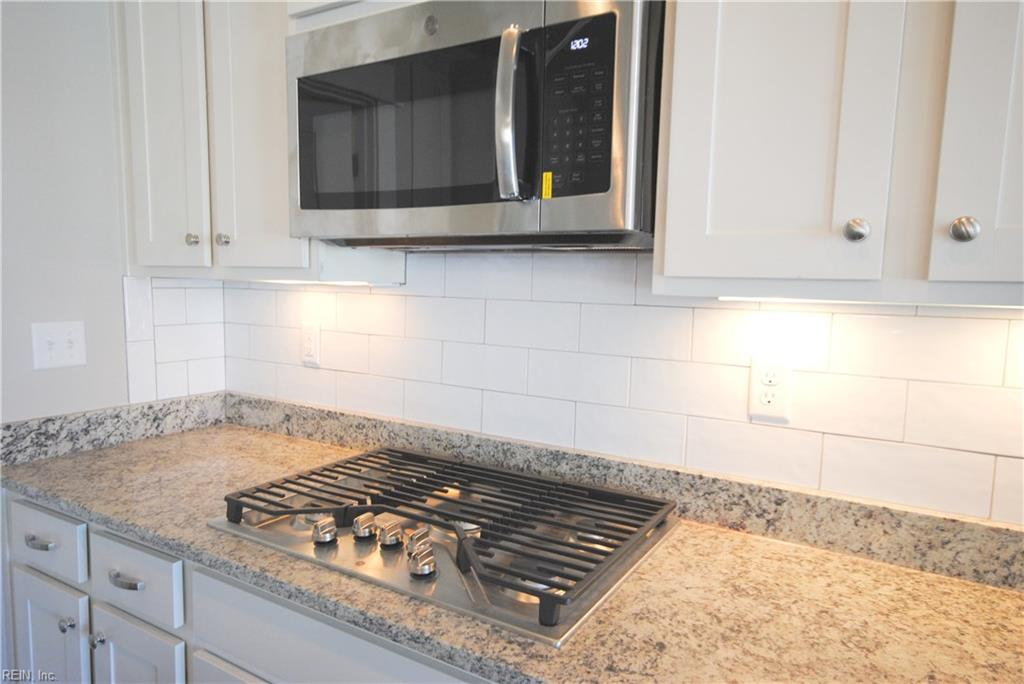 Vented microwave over 5 burner gas cook top.