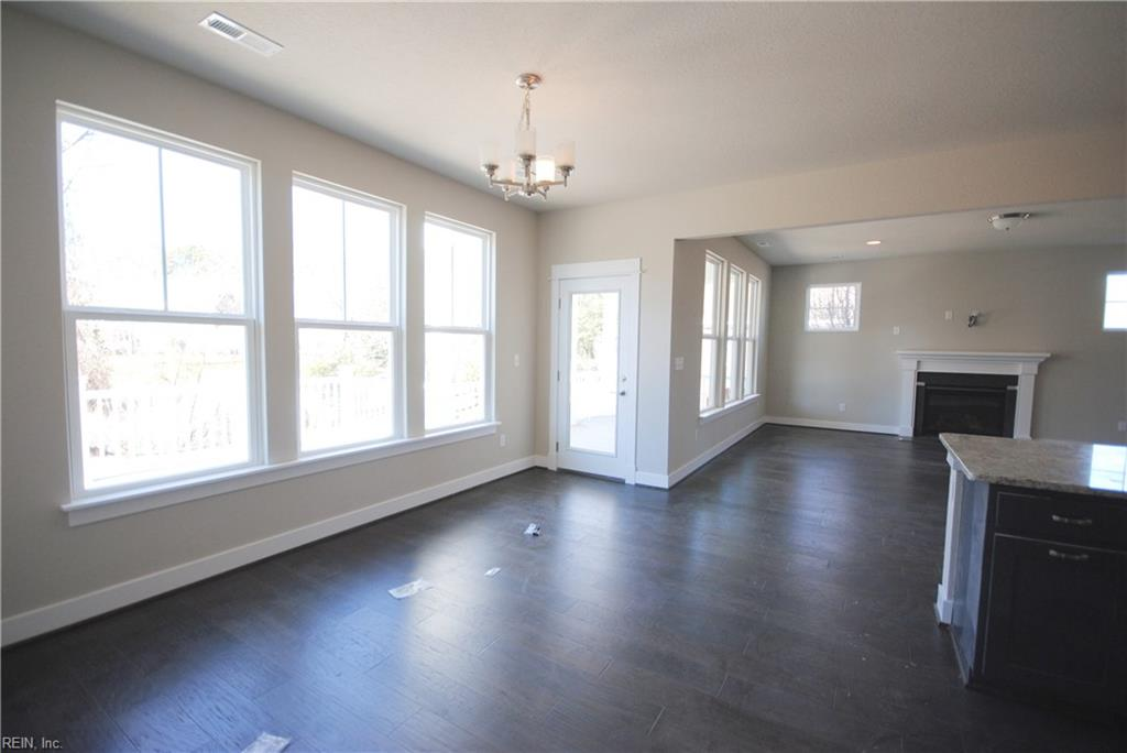 Spacious dining area with windows over looking deck and water view.