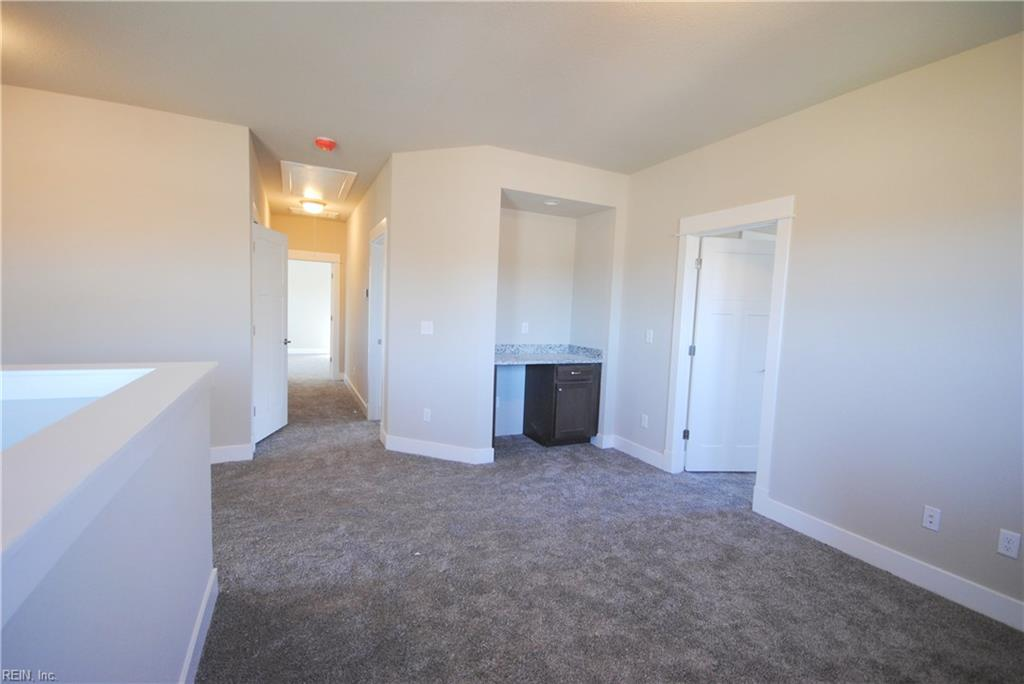 Beverage center in 2nd floor loft with room for mini-fridge and recessed can accent light.