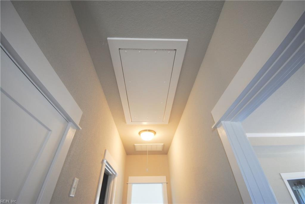 Pull down attic stairs for convenient attic access.
