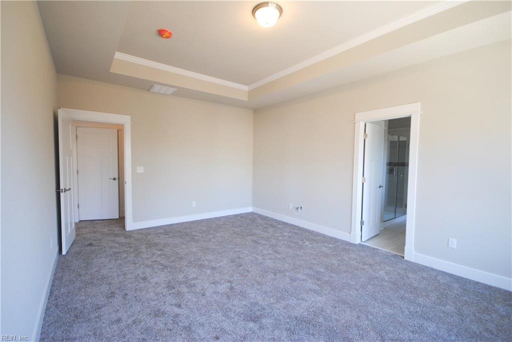 Large master bedroom with ceiling fan pre-wire, tray ceiling with crown moulding and 2 walk in closets!