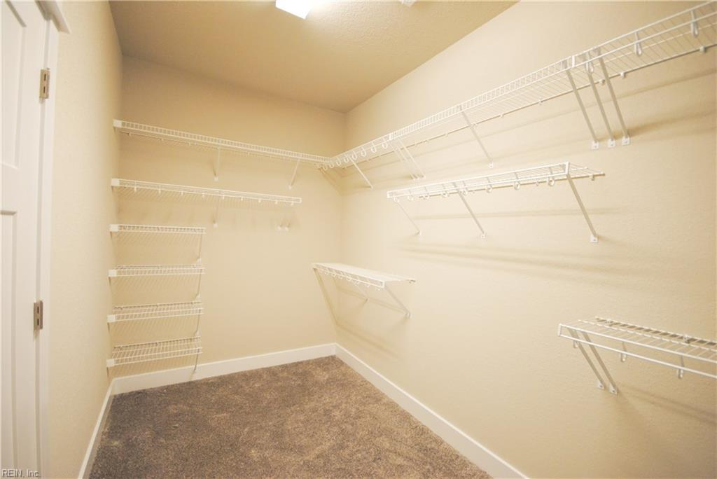 Another view of walk in closet in master bedroom.