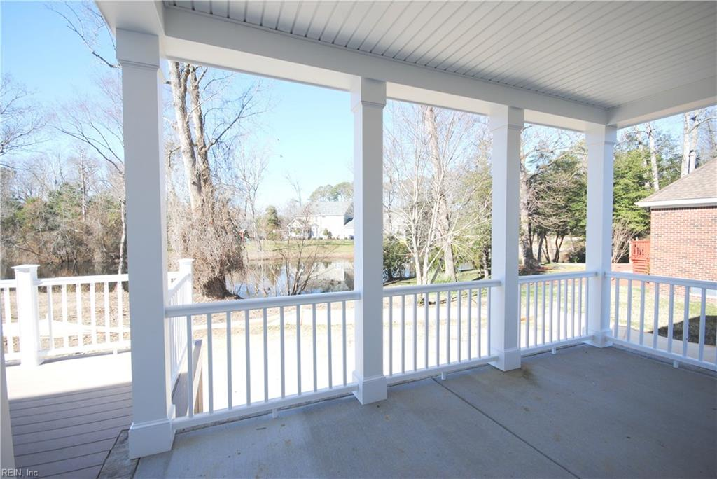 Covered porch off great room.  Water view.