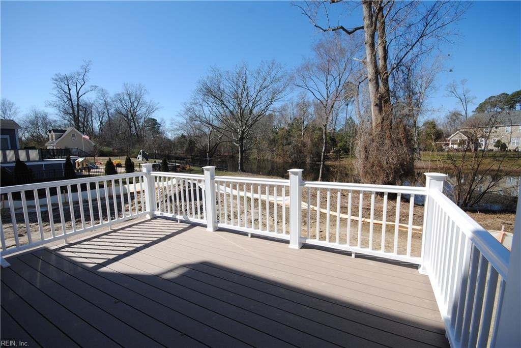 Low maintenance composite decking and vinyl railing.  Water view.