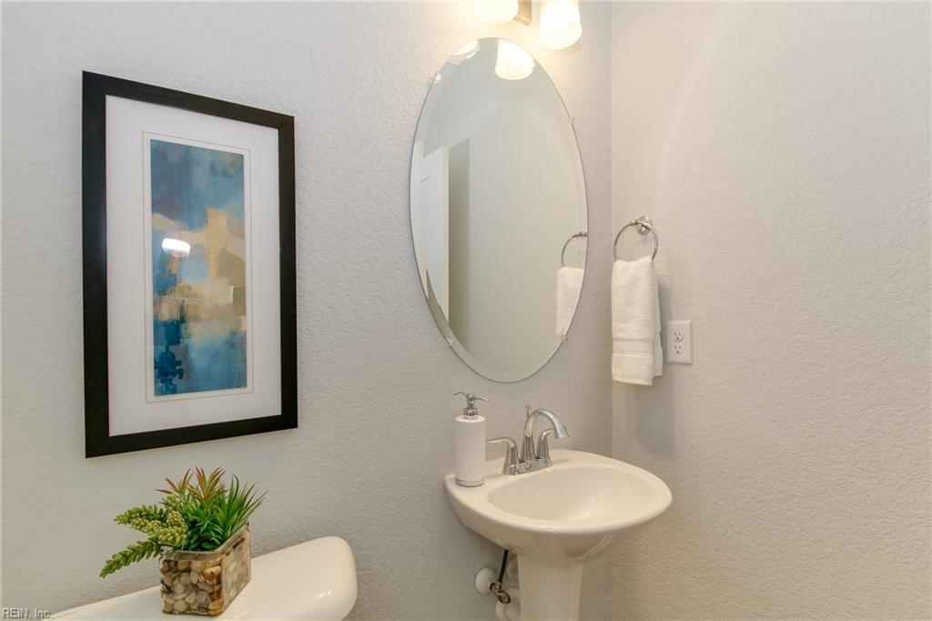 Powder Room on first floor. Photo shown similar to home being built