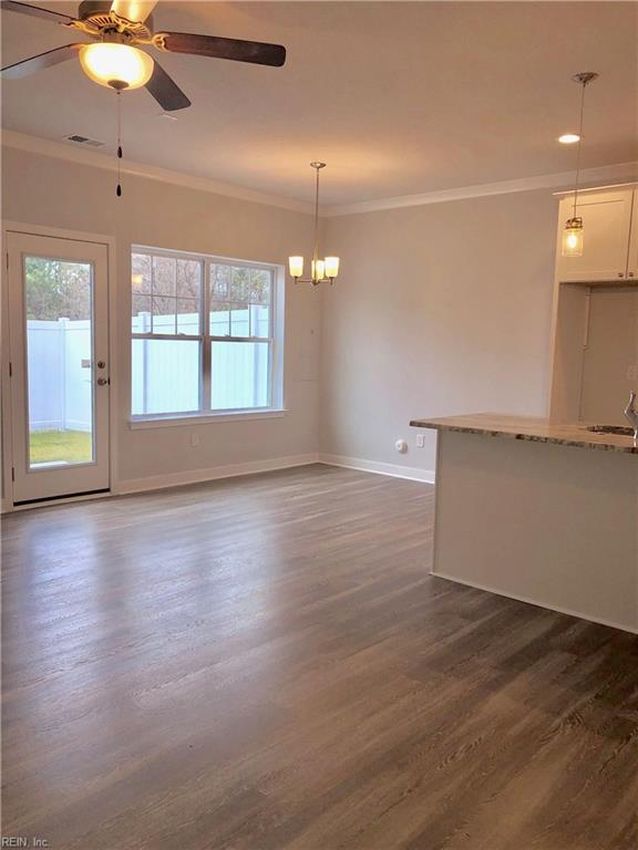 Great Room looking towards dining area and kitchen. Photo shown similar to home being built