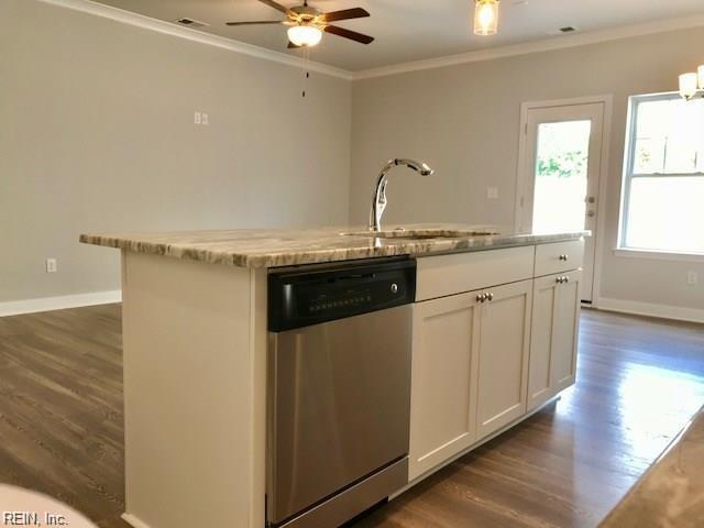 Kitchen Island includes granite countertop, farmhouse sink and gooseneck faucet Photo shown similar to home being built