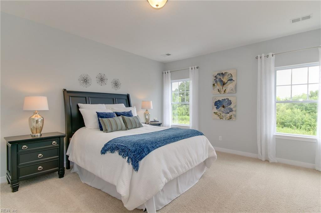 First of two master bedrooms on second floor. Photo shown similar to home being built