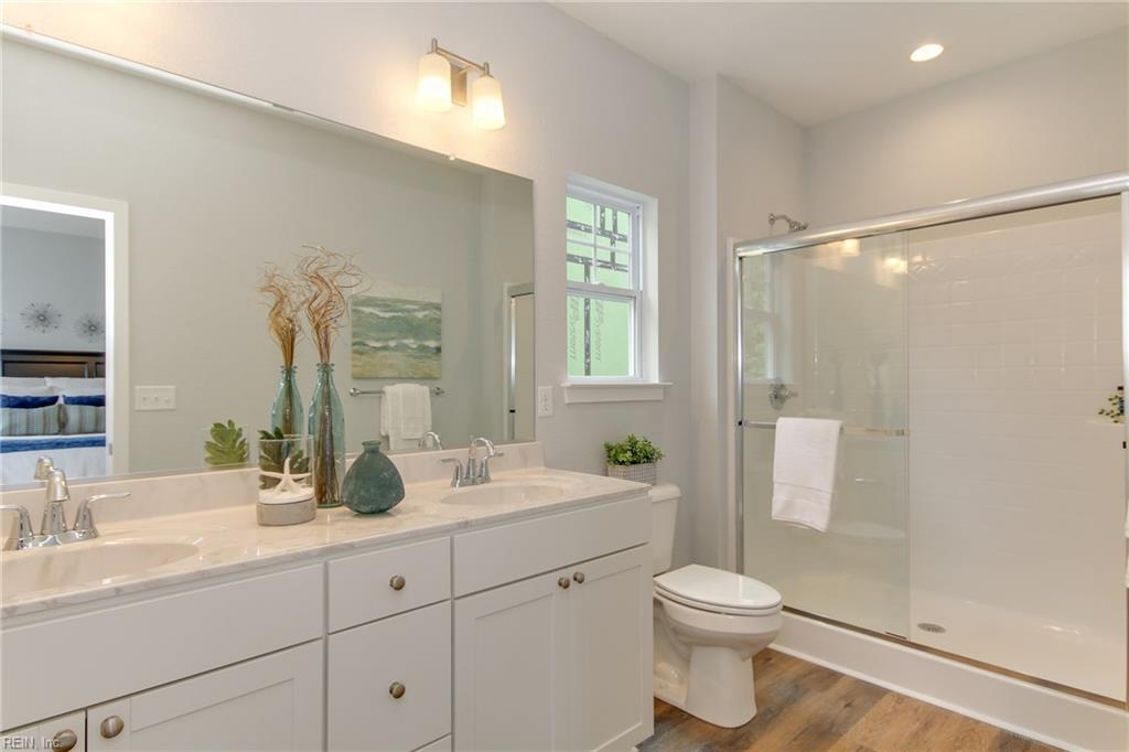 Master Bathroom #1. Bathroom includes adult height double sink vanity and large walk in shower. Photo shown similar to home being built