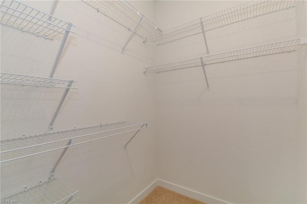 Walk in closet in master bedroom #1. Photo shown similar to home being built.
