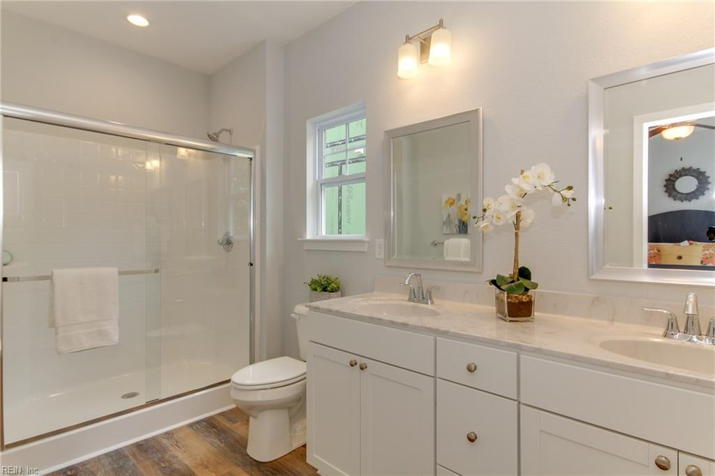 Master bathroom #2 includes adult size vanity with double sink and expansive walk in shower.  Photo shown similar to home being built.