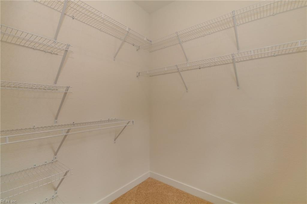 Master bedroom #2 walk in closet.  Photo shown similar to home being built