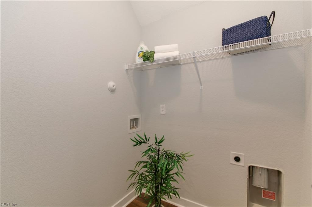 Laundry room easily fits a full sized washer and dryer! Photo shown similar to home being built