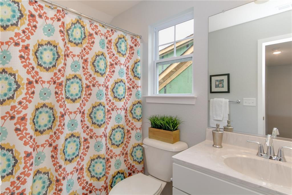 Third floor includes full bathroom! Photo shown similar to home being built