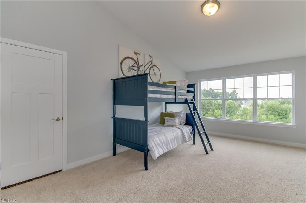 Large bedroom w/ vaulted ceiling adjacent to loft on 3rd floor includes triple window adding tons of light to this great space even on the rainiest days! Photo shown similar to home being built